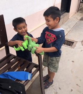 Boys play with the toys made by Sisters